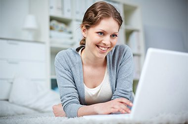 Pretty girl networking on laptop